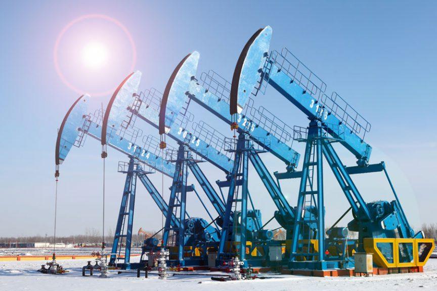 Four Oil Dereks with blue sky